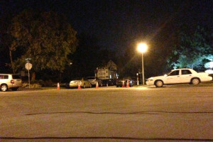 Police cars surround the house in the McConnell's neighborhood.
