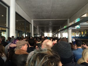 Rally attendees wait outside the Kansas City Convention Center before the doors open to let people in.