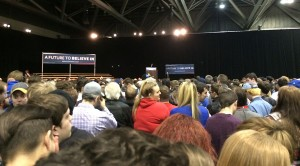 The crowd surrounding the empty stage waits for Sanders to come onstage.