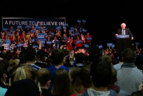 Sanders speaks onstage at the Kansas City Convention Center.