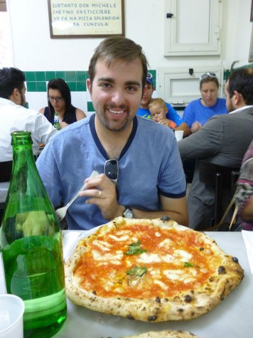 Arbucci poses in a pizzeria during his 2015 summer trip to Naples, Italy (photo courtesy of Arbucci).
