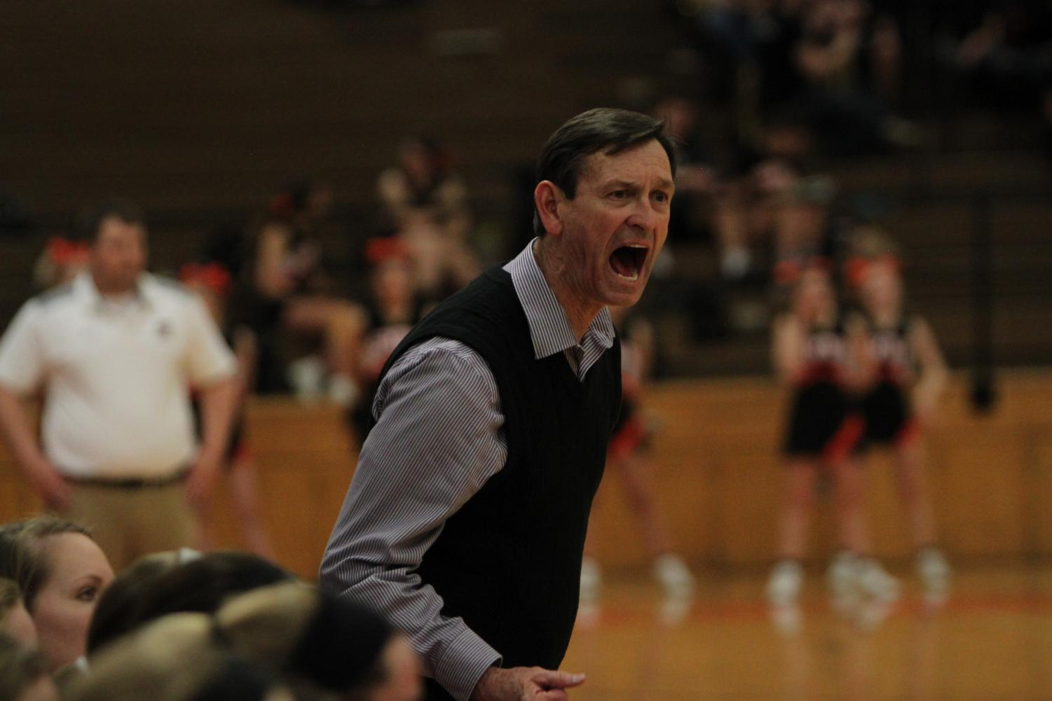 Head coach Brian Bubalo screams at an official during the Huskies substate matchup with Shawnee Mission Northwest at SMNW Feb. 27. The Huskies were defeated by the Cougars, 43-34.