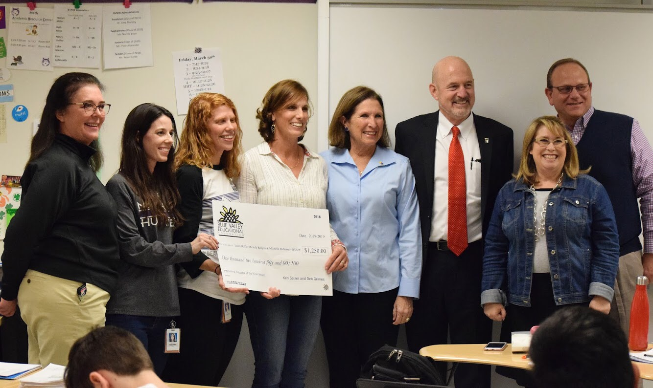 Principal Amy Murphy and district employees present Laura Deffer, Michele Ratigan and Michelle Williams with their Innovative Educators Award.