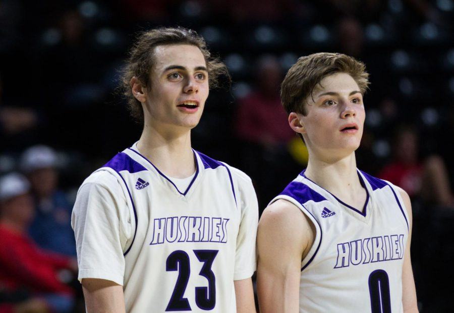 Senior+forward+Parker+Braun+%2823%29+and+junior+guard+Christian+Braun+%280%29+watch+the+action+from+the+bench+after+checking+out+in+the+fourth+quarter+of+the+Huskies+matchup+against+Lawrence+High+at+Charles+Koch+Arena+March+8.+The+Huskies+defeated+the+Lions%2C+65-37.+