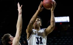 No. 1 Huskies win rematch, defeat No. 8 Lawrence 65-37 in state quarterfinals