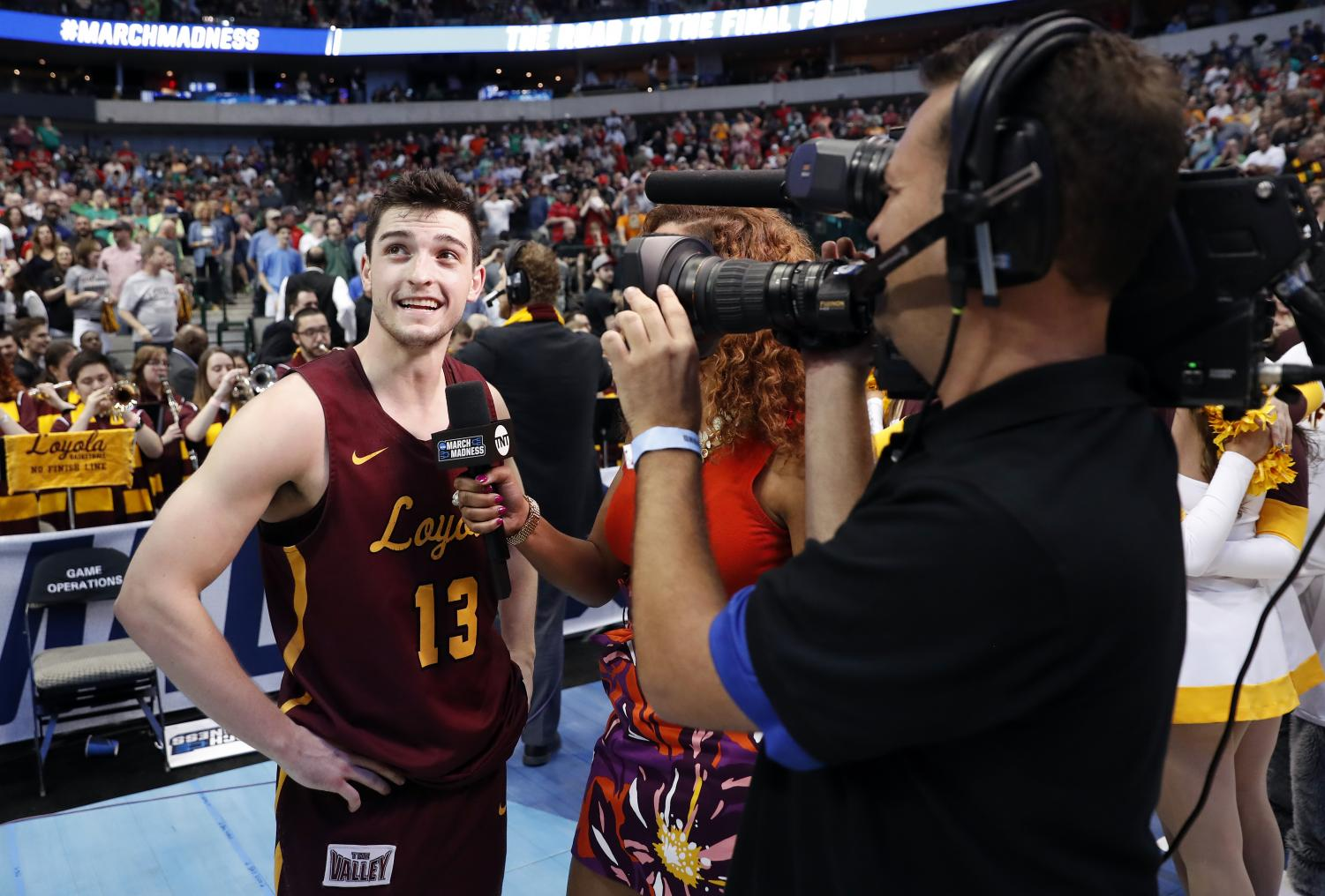 Custer talks to Rosalyn Gold-Anwude of TNT after his game-winner against Tennessee in the second round.